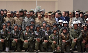 Egypt's President El-Sisi (C) with Egyptian air forces pilots at a North Sinai military air base. Minister of Interior Magdy Abdel-Ghaffar (L) and Minister of Defense Sedki Sobhi (R)