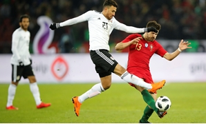 Soccer Football - International Friendly - Portugal vs Egypt - Letzigrund, Zurich, Switzerland - March 23, 2018 Egypt's Trezeguet in action with Portugal's Ruben Neves REUTERS/Arnd Wiegmann