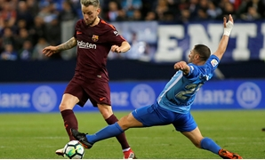 Soccer Football - La Liga Santander - Malaga CF vs FC Barcelona - La Rosaleda, Malaga, Spain - March 10, 2018 Barcelona's IvanRakitic in action with Malaga's Mehdi Lacen REUTERS/Jon Nazca