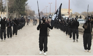 Islamic State militants parade in Tel Abyad, near Syria's border with Turkey. (Yaser Al-Khodor/Reuters)