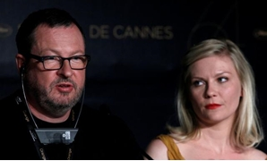 "FILE PHOTO: Director Lars Von Trier (L) and cast member Kirsten Dunst attend a news conference for the film ""Melancholia"", in competition at the 64th Cannes Film Festival, May 18, 2011. REUTERS/Yves Herman/File Photo."