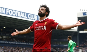 Soccer Football - Premier League - West Bromwich Albion v Liverpool - The Hawthorns, West Bromwich, Britain - April 21, 2018 Liverpool's Mohamed Salah celebrates scoring their second goal REUTERS/Andrew Yates