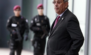 Youssef Boutros-Ghali stands in front of security officers at the venue of the G20 Finance Ministers and Central Bank Governors meeting in Gyeongju - Reuters