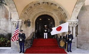 United States Marines stand guard at the front door of U.S. President Donald Trump's Mar-a-Lago estate with U.S. and Japanese flags as they await the arrival of Japan's Prime Minister Shinzo Abe for a bilateral meeting in Palm Beach, Florida U.S., April