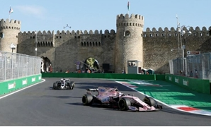 FILE PHOTO - Formula One - F1 - Azerbaijan Grand Prix - Baku, Azerbaijan - June 23, 2017. Force India's Sergio Perez (R) and Haas' Romain Grosjean drive during the second practice session. REUTERS/David Mdzinarishvili