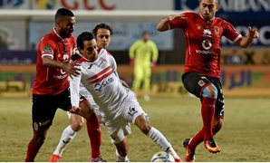 Zamalek's Ayman Hefni vies for the ball against al-Ahly's Ahmed Fathy and Hossam Ashour, AFP