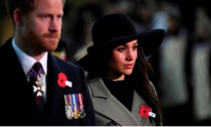 Britain's Prince Harry and his fiancee Meghan Markle attend the Dawn Service at Wellington Arch to commemorate Anzac Day in London, Britain, April 25, 2018. REUTERS/Toby Melville/Pool