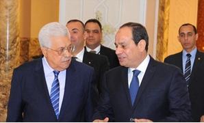 President Sisi (R) talks with Mahmoud Abbas (L) in Cairo - based Ittihadyia Palace - Press photo