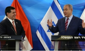 Paraguay's President Horacio Cartes, pictured in 2016 with Israeli Prime Minister Benjamin Netanyahu - AFP/File Photo