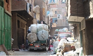 A garbage truck driving through the Streets of Manshiyat Nasser, Mokattam, Cairo - Courtesy to Wikimedia Commons
