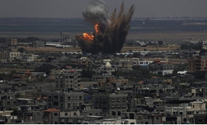 Smoke and flames are seen following what police said was an Israeli air strike in Rafah in the southern Gaza Strip July 8, 2014. REUTERS/Ibraheem Abu Mustafa