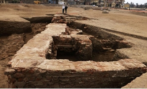 Egyptian archaeological mission at the Supreme Council of Antiquities has uncovered parts of a huge red brick building-Official Facebook Page