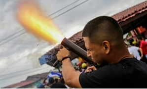 A Nicaraguan university student opposed to President Daniel Ortega fires a hand-held mortar in a neighbourhood in Masaya, a city that was a cradle of the Sandinista movement but is now a hotbed of anti-government resistance