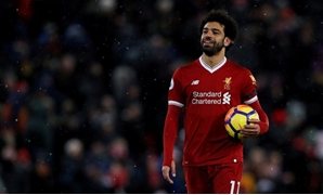 March 17, 2018 Liverpool's Mohamed Salah celebrates with the match ball after the match Action Images via Reuters/Lee Smith