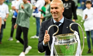 Zinedine Zidane with the Champions League trophy after Real Madrid's win against Liverpool in Saturday's final in Kiev