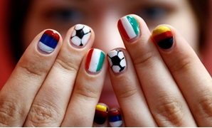 FIFA World Cup - Kaliningrad, Russia - June 15, 2018. Volunteer Ekaterina Semenova poses with her painted fingernails at the media center of Kaliningrad stadium. REUTERS