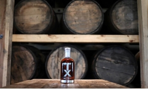A bottle of TX Whiskey is photographed in the TX Tavern at the Firestone & Robertson (F&R) Whiskey Ranch in Forth Worth, Texas, U.S., May 24, 2018. Picture taken May 24, 2018. REUTERS/Adrees Latif