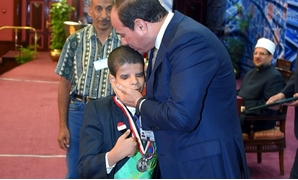 President Sisi honors a Quran reciter with special needs who is under 12 years old - Press photo/Sherif Abdel Moneim