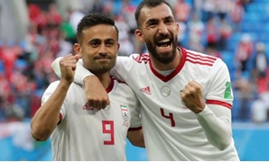 Soccer Football - World Cup - Group B - Morocco vs Iran - Saint Petersburg Stadium, Saint Petersburg, Russia - June 15, 2018 Iran's Omid Ebrahimi and Rouzbeh Cheshmi celebrate after the match REUTERS/Henry Romero