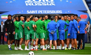 Soccer Football - World Cup - Morocco Training - Saint Petersburg Stadium, Saint Petersburg, Russia - June 14, 2018 Morocco coach Herve Renard and players during training REUTERS/Dylan Martinez