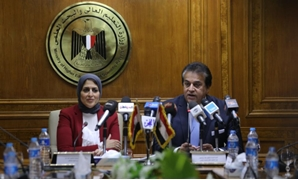 Minister of Higher Education Khaled Abdel Ghaffar (R) meets Minister of Health Hala Zayed (L) Tuesday to address linking hospitals of universities with those of the Health Ministry – Egypt Today/Mohamed Al-Hossari