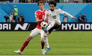 Russia - June 19, 2018 Egypt's Mohamed Salah in action with Russia's Mario Fernandes. REUTERS/Henry Romero