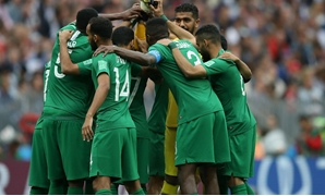 Saudi Arabia team huddle before the match against Russia . REUTERS/Carl Recine