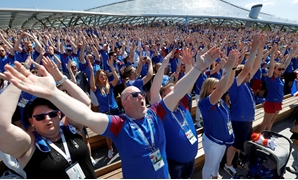 FILE PHOTO: Supporters of Iceland clap as they gather in Zaryadye Park Moscow, Russia - June 16, 2018. REUTERS/Sergei Karpukhin/File Photo