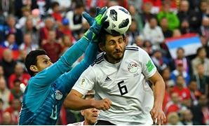 Soccer Football - World Cup - Group A - Russia vs Egypt - Saint Petersburg Stadium, Saint Petersburg, Russia - June 19, 2018 Egypt's Ahmed Hegazi and Mohamed El-Shenawy in action REUTERS/Dylan Martinez