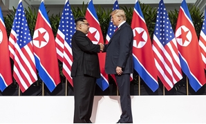 Wikipedia Commons - Kim (L) and Trump (R) shaking hands at the red carpet during the DPRK–USA Singapore Summit