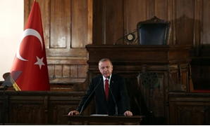 Turkish President Tayyip Erdogan makes a speech at the old parliament building in Ankara, Turkey July 13, 2018. REUTERS/Umit Bektas