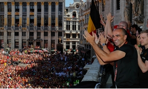 Soccer Football - World Cup - Belgium - Brussels, Belgium - July 15, 2018. Belgian soccer team coach Roberto Martinez waves to the fans while appearing on the balcony of the city hall at the Brussels' Grand Place, after taking the third place in the World