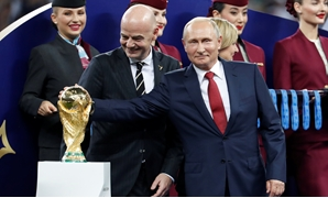July 15, 2018 FIFA president Gianni Infantino and President of Russia Vladimir Putin with the World Cup trophy before the medals ceremony REUTERS/Damir Sagolj
