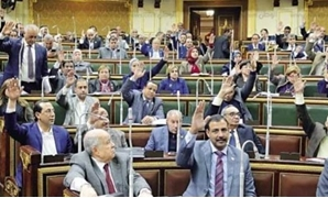 Egyptian Parliamentarians vote in favor of a proposal – Press photo