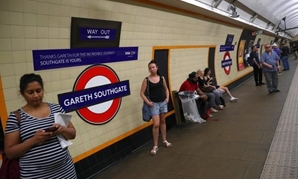 Passengers wait at Southgate Underground Station, temporarily renamed as 'Gareth Southgate' in honour of England soccer team manager Gareth Southgate, in London, Britain July 16, 2018. REUTERS/Hannah McKay