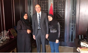 Egypt's charge d'affaires in Syria Mohamed Tharwat Selim with the Egyptian family - Press photo/Ministry of Foreign Affairs