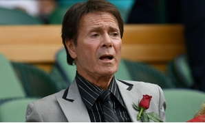 British musician Cliff Richard, seen here at Wimbledon, was Britain's first home-grown pop star-AFP/File / Glyn KIRK