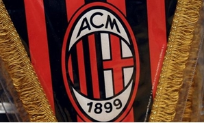 FILE PHOTO: The AC Milan logo is pictured on a pennant in a soccer store in downtown Milan, Italy April 29, 2015. REUTERS/Stefano Rellandini/ Picture Supplied by Action Images/File Photo