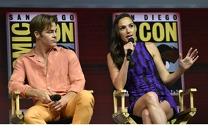 "Chris Pine (L) and Gal Gadot participate in the Warner Bros. Theatrical Panel for ""Wonder Woman 1984,"" which Gadot described as a ""new chapter"" rather than a sequel."