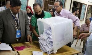 Employees count ballots after polls closed in the first phase of parliamentary elections at a voting center in Dokki, Giza governorate, Egypt, October 19, 2015 – Reuters