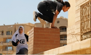 "Egyptian women from Parkour Egypt ""PKE"" practice their parkour skills around buildings on the outskirts of Cairo, Egypt July 20, 2018. REUTERS/Amr Abdallah Dalsh"