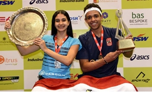 FILE - Asal and Rawan celebrating their titles