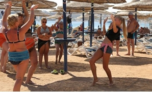 A Russian employee of a hotel teaches belly dancing to Russian tourists in Sharm el-Sheikh on Tuesday. Photograph: Asmaa Waguih/Reuters