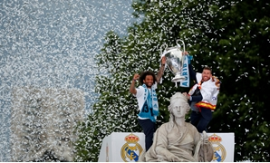 FILE PHOTO: Soccer Football - Real Madrid celebrate winning the Champions League Final - Madrid, Spain - May 27, 2018 Real Madrid's Sergio Ramos and Marcelo celebrate during victory celebrations REUTERS/Paul Hanna/File Photo