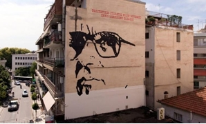 A giant mural depicts Italian composer Ennio Morricone created by Asterios Laskaris, Christos Laskaris and Dimitra Kalogirou under the auspices of the Greek Cultural Association Friends of Ennio Morricone's Music, in Larissa, Greece, July 24, 2018. REUTER