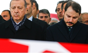 Turkish President Tayyip Erdogan, accompanied by Energy Minister Berat Albayrak, attends a funeral ceremony for police officer Hasim Usta who was killed in Saturday's blasts, in Istanbul, Turkey, December 12, 2016. REUTERS/Osman Orsal/File Photo