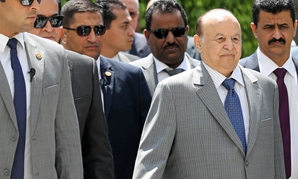 Yemeni President Abd-Rabbu Mansour looks on as he is surrounded by security after his meeting with Arab League Secretary General Ahmed Aboul Gheit in Cairo, Egypt August 14, 2018. REUTERS/Mohamed Abd El Ghany