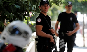 Police officers patrol outside the home of U.S. pastor Andrew Brunson in Izmir, Turkey August 17, 2018. REUTERS/Osman Orsal
