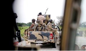 FILE PHOTO: A Nigerian army convoy vehicle drives ahead with an anti-aircraft gun, on its way to Bama, Borno State, Nigeria August 31, 2016. Picture taken from inside a vehicle. REUTERS/Afolabi Sotunde/File Photo