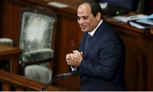 FILE - President Abdel Fatah al-Sisi reacts after delivering a speech at the lower house of parliament in Tokyo on February 29, 2016 - Reuters
